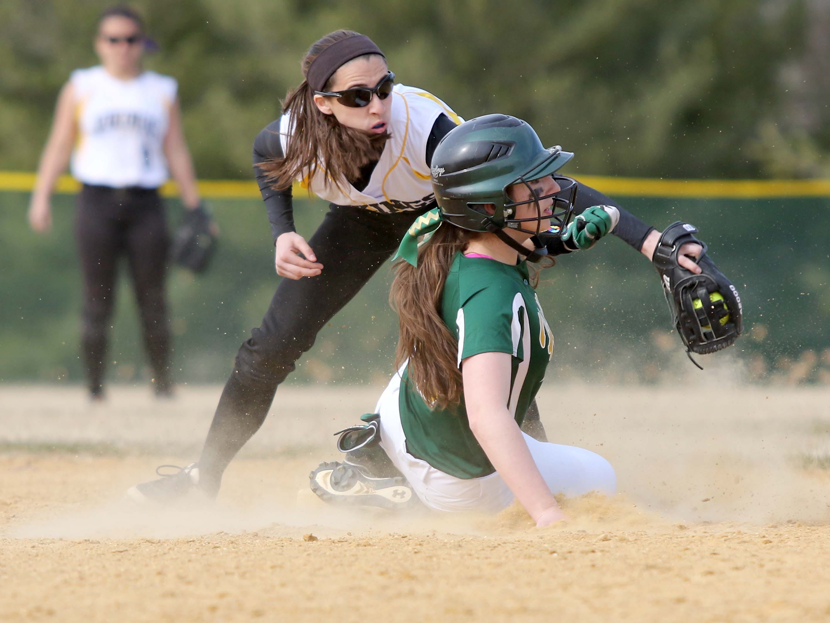 South Brunswick's #1 Carly Rybinski applies a tag on #8 Kayla Smith of J.P. Stevens, at second base, as she tries to steal. High School softball, J.P. Stevens at South Brunswick, April 2, 2015