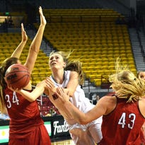 New Mexico State freshman Brooke Salas goes up between two Southern Utah players for a lay up during Tuesday's game at the Pan Am Center.