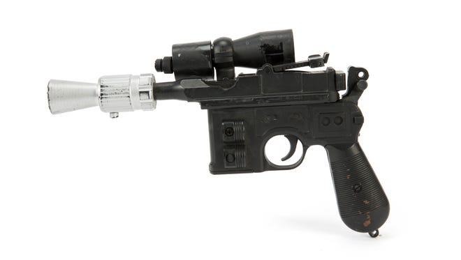 "This photo provided by Julien's Auctions shows character Han Solo's BlasTech DL-44 blaster from the Star Wars trilogy film ""Return of the Jedi"" (Lucasfilm, 1983) that sold for $550,000 at Julien's Auctions Hollywood Legends auction at Planet Hollywood Resort & Casino, in Las Vegas, on Saturday, June 23, 2018.  Julien's Auctions say Ripley's Believe It Or Not purchased the sci-fi weapon. (Julien's Auctions via AP)"