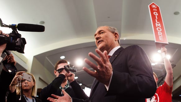 Jim Gilmore talks with the media in the spin room after