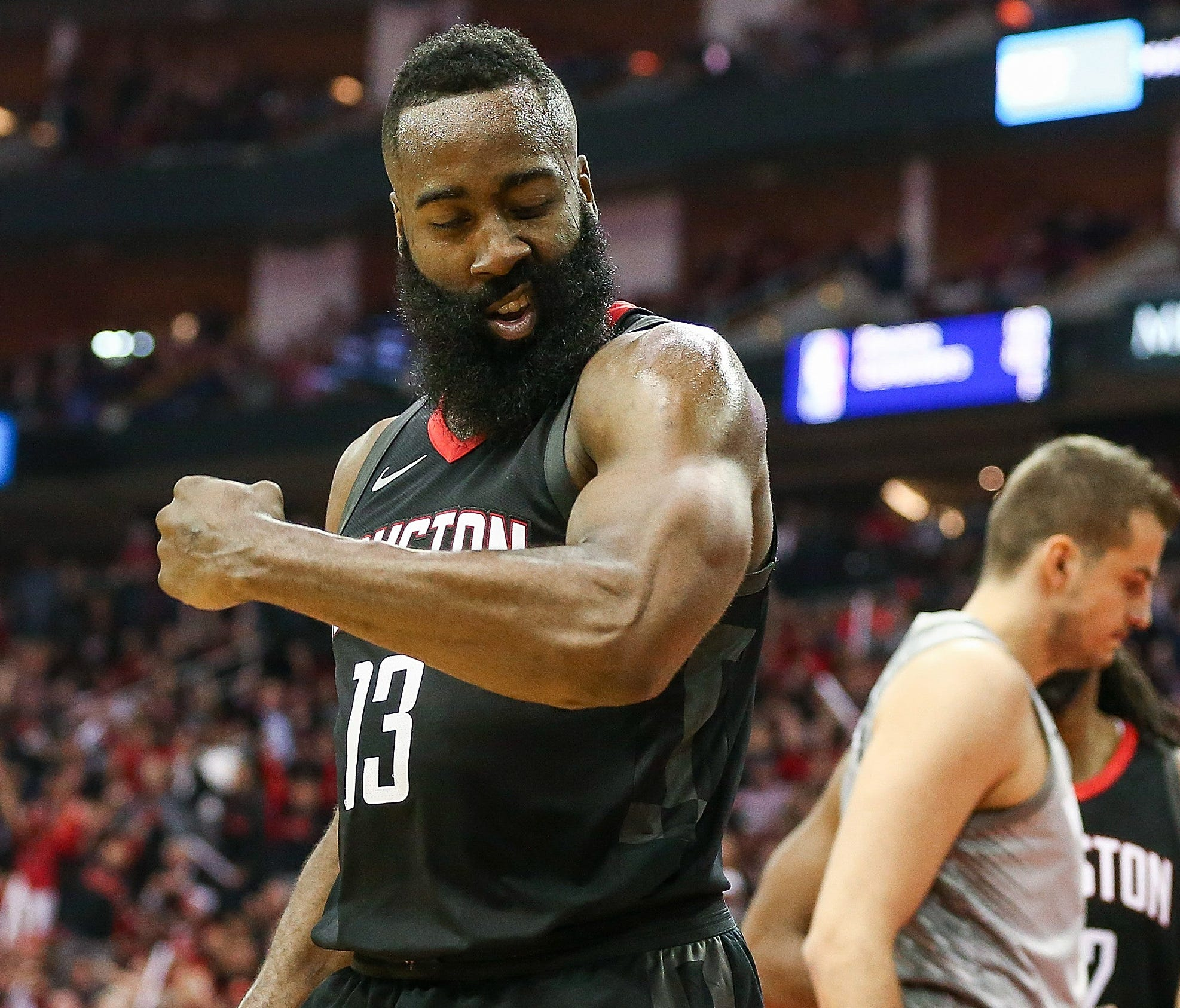 Houston Rockets guard James Harden reacts after scoring as Minnesota Timberwolves forward Nemanja Bjelica looks on during the third quarter in Game 1.