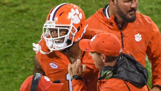 Clemson head coach Dabo Swinney, right, smiles with wide receiver Trevion Thompson(1) after a touchdown to his teammate tight end Milan Richard (80) during the first quarter in Memorial Stadium at Clemson on Saturday.