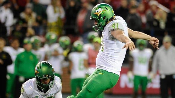 Oct 1, 2016; Pullman, WA, USA; Oregon Ducks place kicker Aidan Schneider (41) attempts a field goal against the Washington State Cougars during the second half at Martin Stadium. The Cougars won 51-33. Mandatory Credit: James Snook-USA TODAY Sports