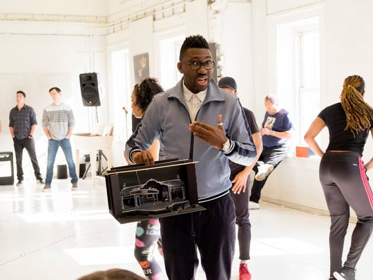 "Director Kwame Kwei-Armah holds a model of the stage for the new theatrical production ""SOUL The Stax Musical,"" which opens at the Baltimore Center Stage theater in May 2018. The production traces the history of Stax Records, which was founded in Memphis, Tenn."