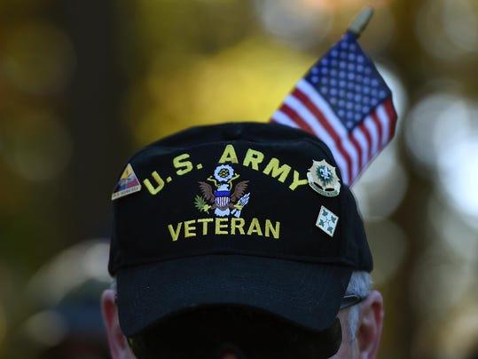 Defense Secretary Hagel Marks Veterans Day At The Vietnam War Memorial