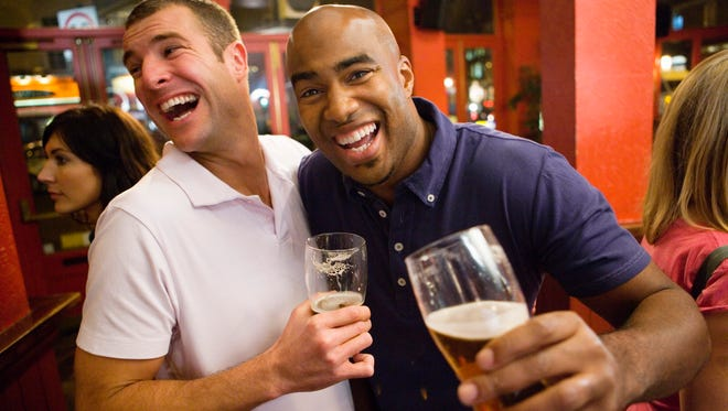 Laughing men with beers