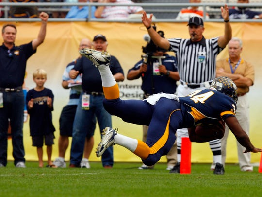 Carlos Hyde flies into the end zone for a score in the first quarter as the Naples High School football team plays St. Augustine in the Class 3A championship game at the Citrus Bowl on Dec. 14, 2007, in Orlando.