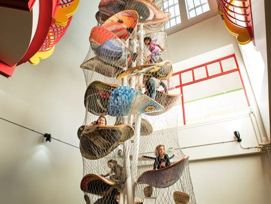 Kids can have fun climbing on a work of art at the