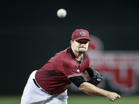 Arizona Diamondbacks' Zach Godley (52) pitches against