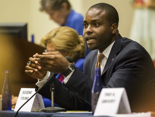 Eugene Young speaks during a forum with candidates