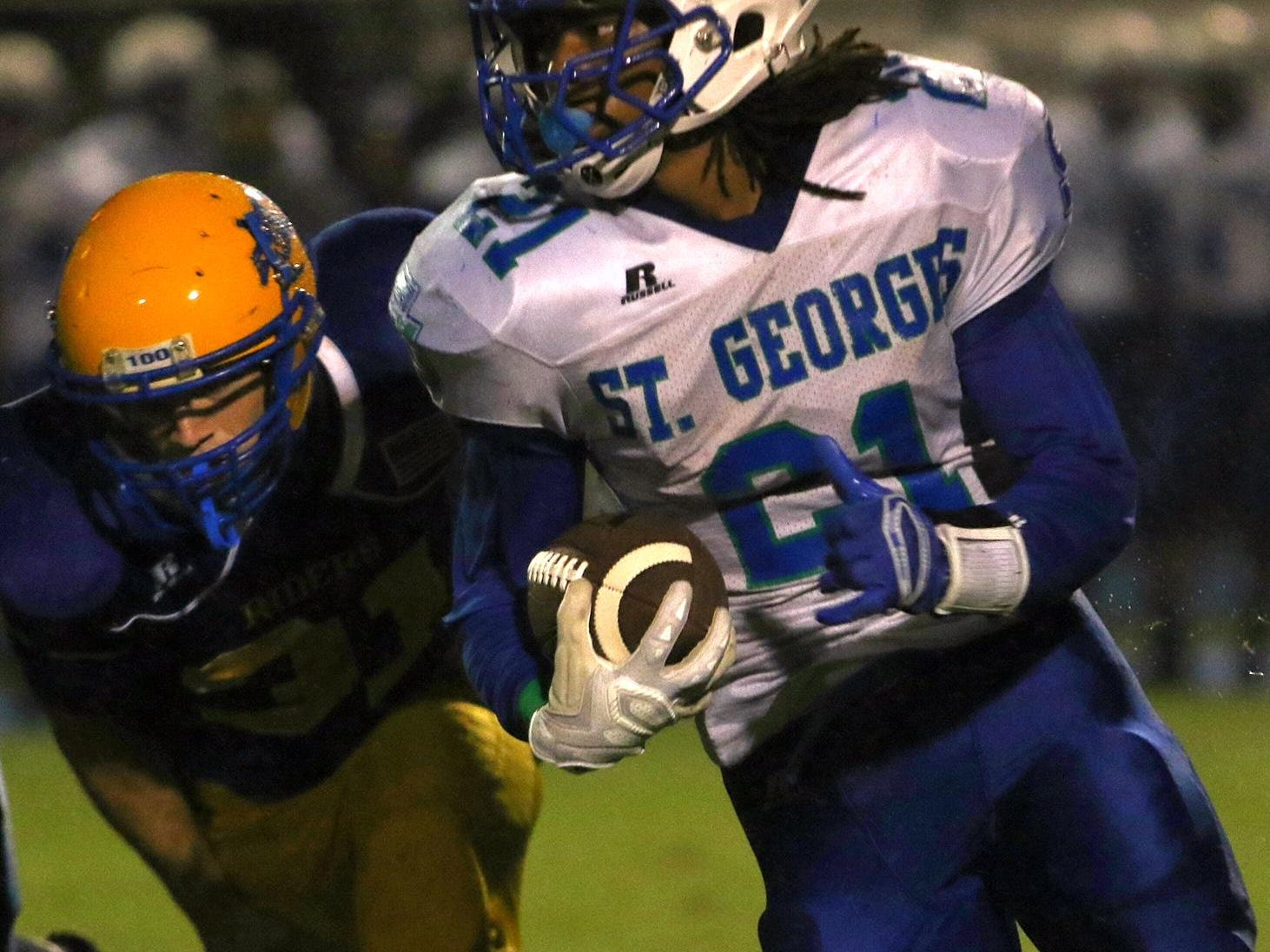 St. Georges running back Gary Brightwell carries the ball during the third quarter.