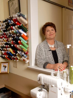 Designer Judy Kessinger poses in her sewing studio with her thread and Baby Lock Serger.  Jan. 18, 2016