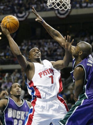 Mike James (7) won an NBA title with the Detroit Pistons more than a decade ago. Now, he promotes non-violence and helps mentors school kids through the Sports Power Organization based in Baltimore. His team of former NBA players will take on a hometown all-star team at William Penn High on April 21.
