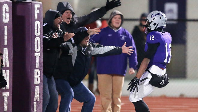 Ben Davis RB Chris Evans is being courted by the Wolverines' biggest rival.