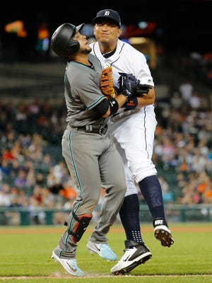 Tigers first baseman Miguel Cabrera (24) and Diamondbacks leftfielder Gregor Blanco (5) collide on the base path during the eighth inning of the Tigers' 7-6 loss Tuesday at Comerica Park.