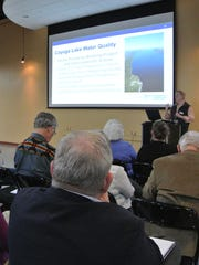 New York State Department of Environmental Conservation officials discuss plans to create a cleanup plan for Cayuga Lake during a public meeting Wednesday night in Ithaca. About 50 people attended.