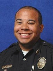 Louisville police officer Brandon Wood is one of two