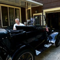 Ted O'Dell  talks about the cars he owns and collects in his garage Tuesday, July 26, 2016, in Lansing. He will be bringing his 1923 Ford Model T, foreground, at the R.E. Olds Museum Car Capital Auto and Bike Show. A Ford Model A car is in the background.