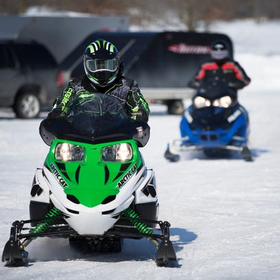 Mark Boff and Marc Wiggins of Ogden head out to a snowmobiling