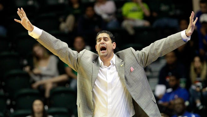 South Florida Bulls head coach Orlando Antigua reacts from the sidelines against the Temple Owls on Jan. 31, 2016.
