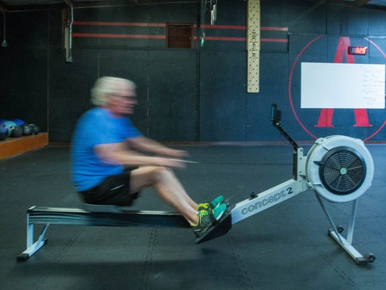 Las Crucen John LeRoy, 81, demonstrates his technique on a rowing machine at CrossFit Las Cruces on Thursday, April 5.