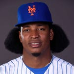 New York Mets relief pitcher Jenrry Mejia (58) poses for media day portraits at Tradition Field in February of 2015.