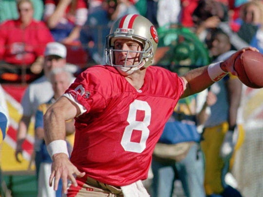 In this Nov. 26, 1995 photo, San Francisco 49ers quarterback Steve Young throws against the St. Louis Rams.