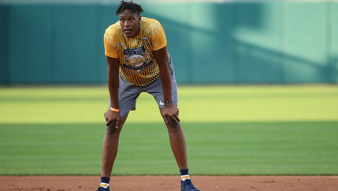 Indiana Pacer Myles Turner waits to run from second base, during the 9th annual Caroline Symmes Celebrity Softball Challenge at Victory Field in Indianapolis, Thursday, June 15, 2017.