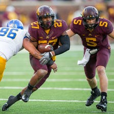 Sep 20, 2014; Minneapolis, MN, USA; Minnesota Golden Gophers running back David Cobb (27) rushes around San Jose State Spartans defensive end Cedric Lousi (96) in the second half at TCF Bank Stadium. The Gophers won 24-7. Mandatory Credit: Jesse Johnson-USA TODAY Sports