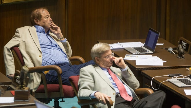 Reps. Franklin Pratt (left) and Vince Leach listen on the last day of their session at the state Capitol in Phoenix on April 2, 2015.