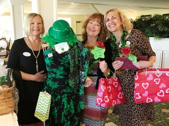"Terri Lebel, left, Sue Riordan and Carole Romano enjoy the Woman's Club of Stuart's ""Food, Friends & Fashion"" luncheon March 17, 2018, presented by the Girlfriends Committee."