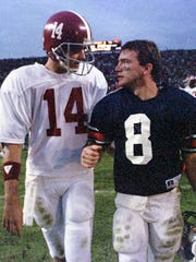 Alabama quarterback Gary Hollingsworth (14) greets his cousin, Auburn wide receiver Shayne Wasden (8), after the Iron Bowl at Jordan-Hare Stadium in Auburn, Ala., on Dec. 2, 1989.