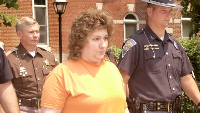 Judy Kirby is led from the Morgan County Courthouse in Martinsville Wednesday, June 13, 2001.