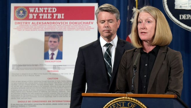 Acting Assistant Attorney General Mary McCord, right, accompanied by U.S. Attorney for the Northern District Brian Stretch, speak during a news conference at the Justice Department in Washington about the security breach at Yahoo.