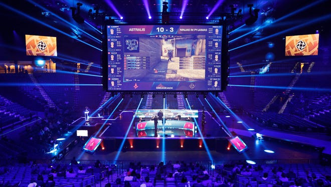 In this Feb. 18, 2017, file photo, teams compete against each other during the Dreamhack Masters e-sports tournament at the MGM Grand Garden Arena in Las Vegas. The Las Vegas Strip is getting its first space dedicated for competitive gaming when the Luxor hotel-casino transforms its nightclub into a multi-level e-sports arena. MGM Resorts International on Tuesday said the venue is expected to open in early 2018.
