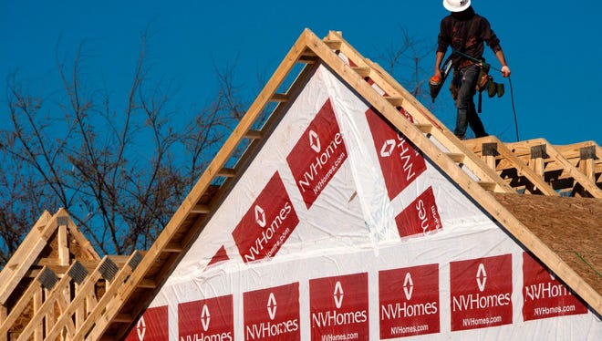 This file photo taken on March 8, 2017 shows a construction worker installing a rooftop on to a new home being built in Fairfax, Virginia.  Sales of new homes in the United States forged higher for the third straight month in March, hitting the fastest pace since July, the Commerce Department reported on April 25, 2017. The acceleration came as the volume of new houses for sale reached its highest level in nearly eight years, pointing to homebuilders' efforts to meet consistently strong demand in a tight market.