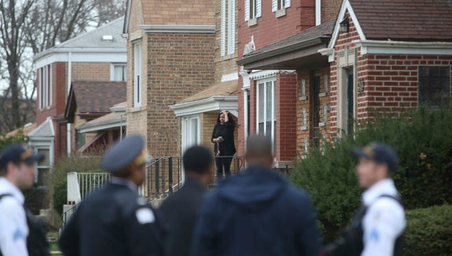 Authorities gather outside a home on the South Side of Chicago, Monday morning, April 10, 2017, after Cook County Circuit Court Judge Raymond Myles was shot to death outside his home. Myles was an associate judge in the court's criminal division.