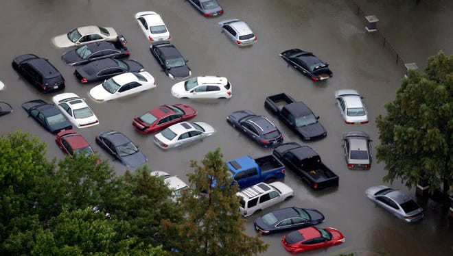 "Cars float in Houston floodwater this week. Auto industry and insurance industry officials say some flood damaged cars will ""absolutely"" make their way back into the nation's automotive fleet, and used car buyers need to be extra vigilant to avoid being stuck with one."