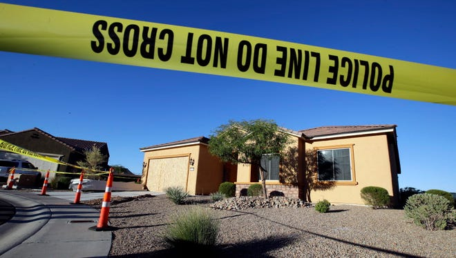 Police tape blocks off the home of Stephen Paddock on Monday, Oct. 2, 2017, in Mesquite, Nev. Paddock killed dozens and injured hundreds on Sunday night when he opened fire at an outdoor country music festival in Las Vegas.