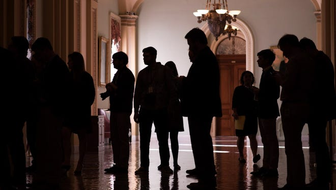 Reporters wait for the arrival of senators for vote on the tax bill on Capitol Hill in Washington, D.C. on December 1, 2017.