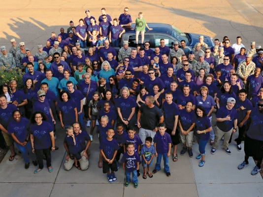 Participants in this year's Big Give pose for a photo outside Club Holloman at the Big Give after party on Aug 21.This year's Big Give consisted of 540 volunteers in 40 teams working a total of 7,292 hours and saving the community 458,431.98.