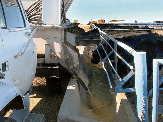Courtesy Photo   A feed truck is used to feed cattle at NMSU's Clayton Livestock Research Center.