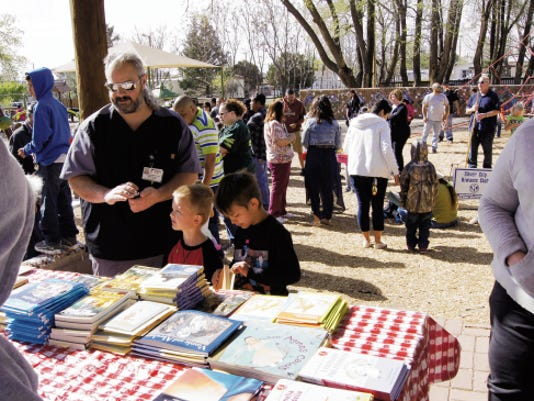 More than 260 free books were given away to children at the Kiwanis Club community Easter Egg Hunt, held on Saturday in Penny Park in Silver City. Randal Seyler - Sun-News