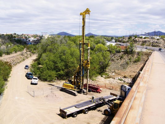 Workers prepare on Tuesday for the demolition of the Hudson Street Bridge, which is expected to close on Monday, redirecting traffic to the Truck Bypass Road and Highway 180. Randal Seyler - Sun-News