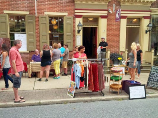 Shoppers at Sweet Melissa's Dream & Lotus Moon Yoga browse sidewalk sales along North Beaver Street during last year's August First Friday York.
