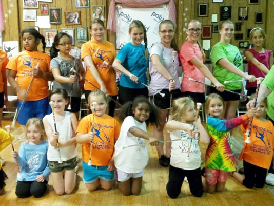 Bonnie Kupp of Bonnie Kupp School of Baton and Dance at 201 E. Penn Ave., Cleona, poses with one her classes. Thousands of students have attended the school over the past 50 years.