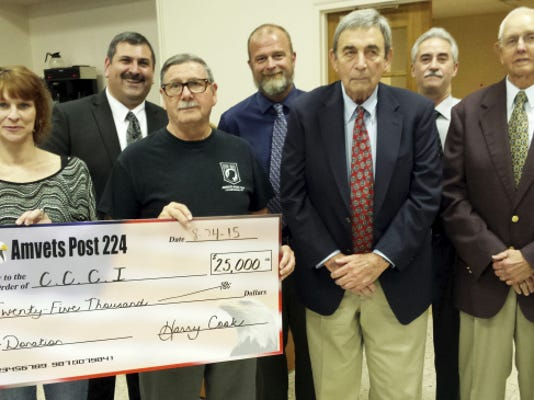 Chambersburg's Amvets Post 224 contributed 25,000 Monday to a campaign to fund extensive repairs at the borough's pool. From left are, Post 224 Manager Tiffany Black, Borough Manager Jeffrey Stonehill, Post 224 President Harry Cook, Guy Shaul of the borough park and recreation department, Richard Jenkins of Chambersburg Community Centers Inc. (CCCI), Councilman Brad Elter and Gaylord Peters of CCCI.