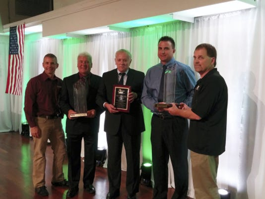 Randy Kuhn, second from left, Robert Moser and Brett Rockers were all honorary recipients Thursday night at the Franklin County Area Development Corporation's 29th annual industry appreciation awards dinner at Green Grove Gardens.