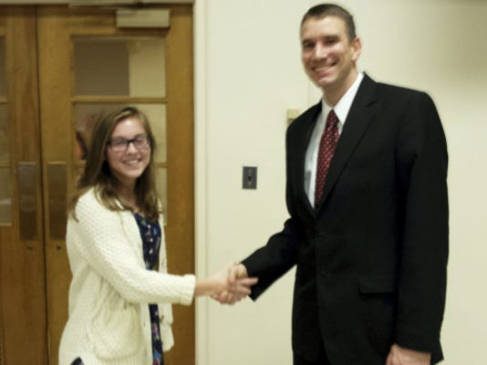 Dale Heberlig — PUBLIC OPINION Haley Frey, left, was sworn in as a junior member of Chambersburg Borough Council, by Mayor Darren Brown on Monday.
