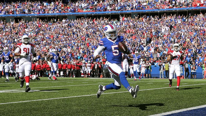 Bills quarterback Tyrod Taylor high steps into the end zone for a 20-yard touchdown scramble.